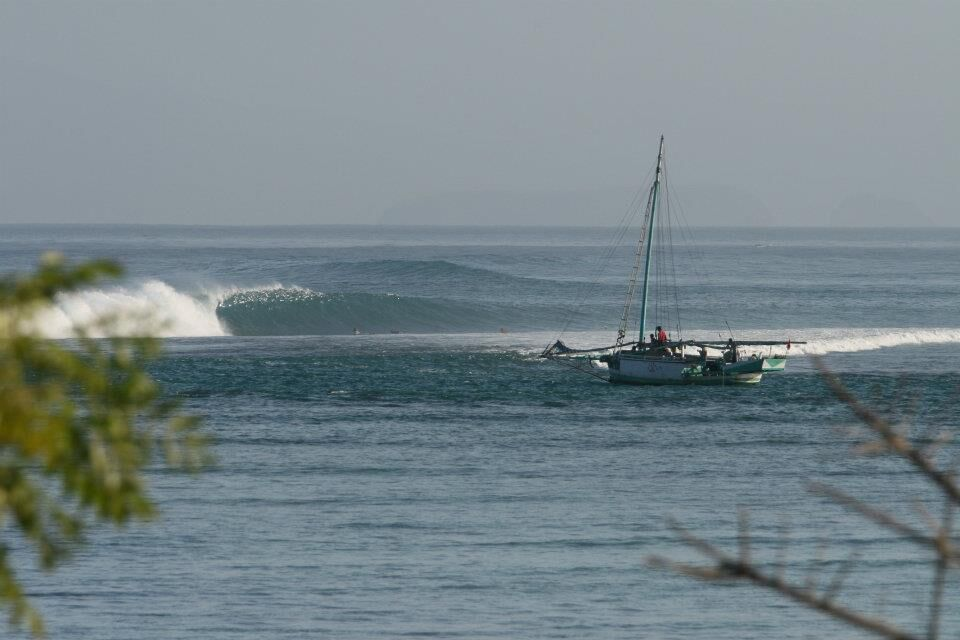 surfing Scar Reef in Sumbawa