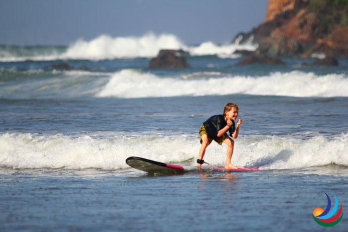 surfing at red island indonesia